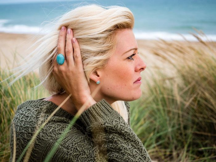 blue-gemstone-ring-and-abolne-earrings-on-the-beach-1