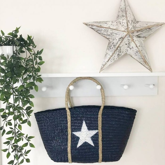seagrass shopper bag hanging in the home