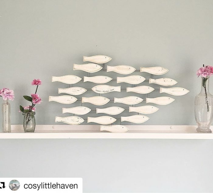 fish shoal wall art hanging in the home
