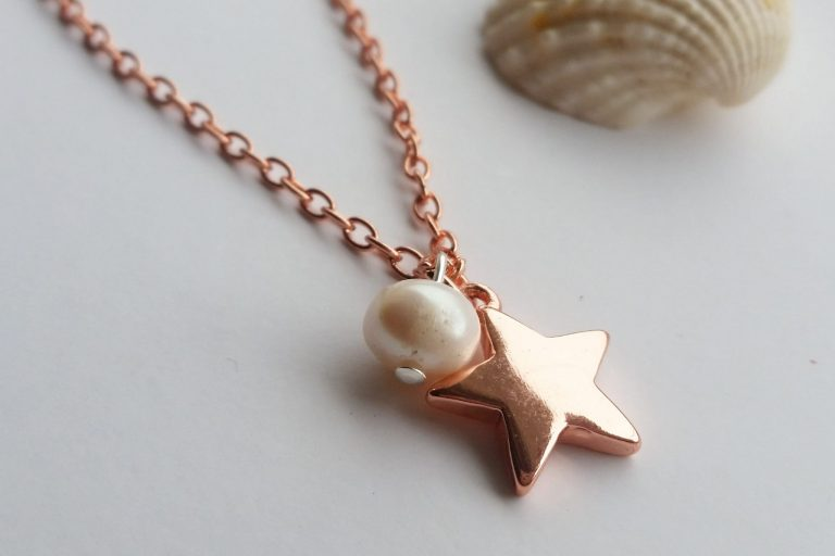 rose gold plated chain and rose gold star pendant and fresh water pearl beach themed necklace