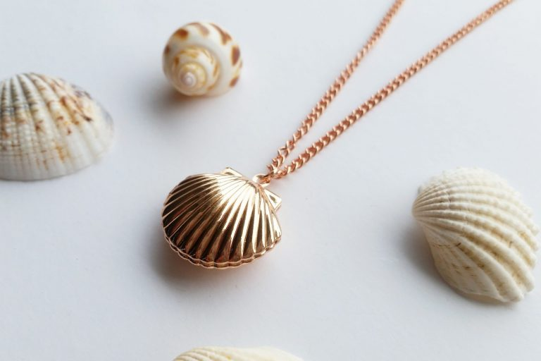 rose gold beach themed jewellery sea shell locket necklace