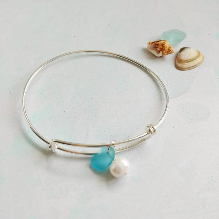 adjustable Sterling Silver bangle featuring a fresh water pearl and beautiful genuine bright blue sea glass pendant