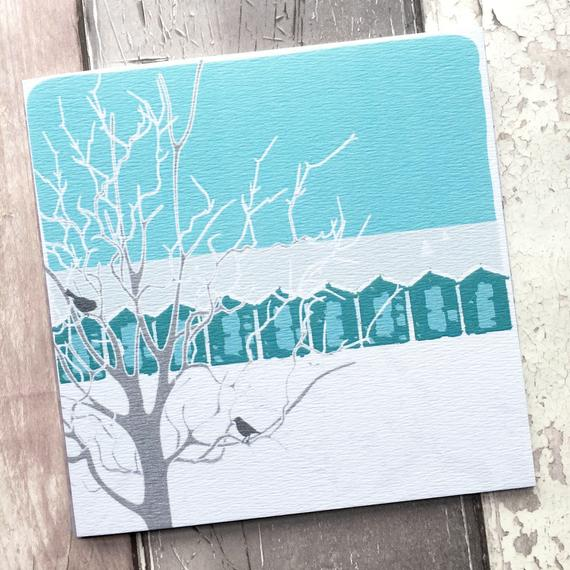 snowy beach huts card