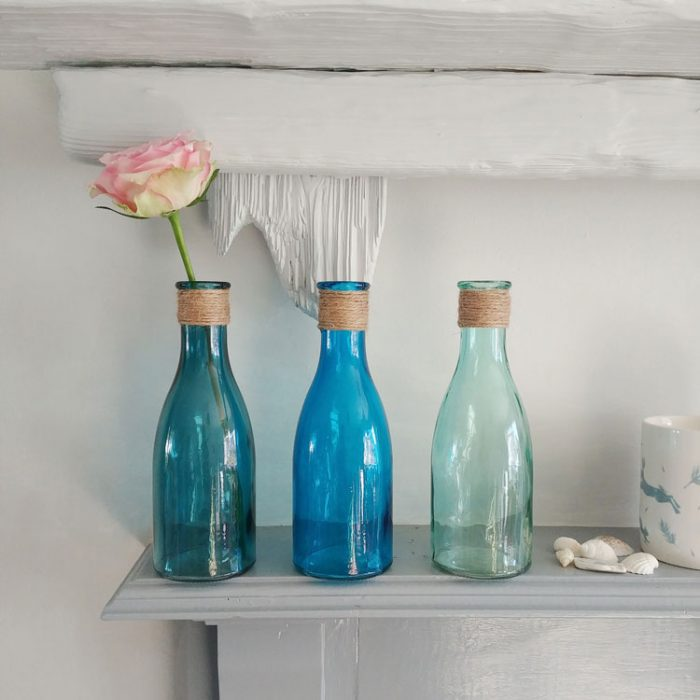 set of three glass bottles