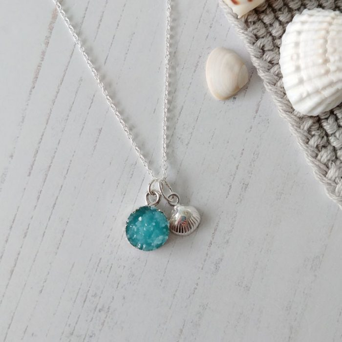 Blue resin druzy pendant and sterling silver clam shell pendant on sterling silver fine chain