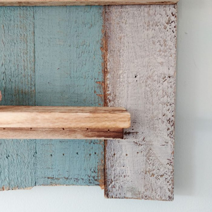 Blue and white striped wooden driftwood style beach hut shelves