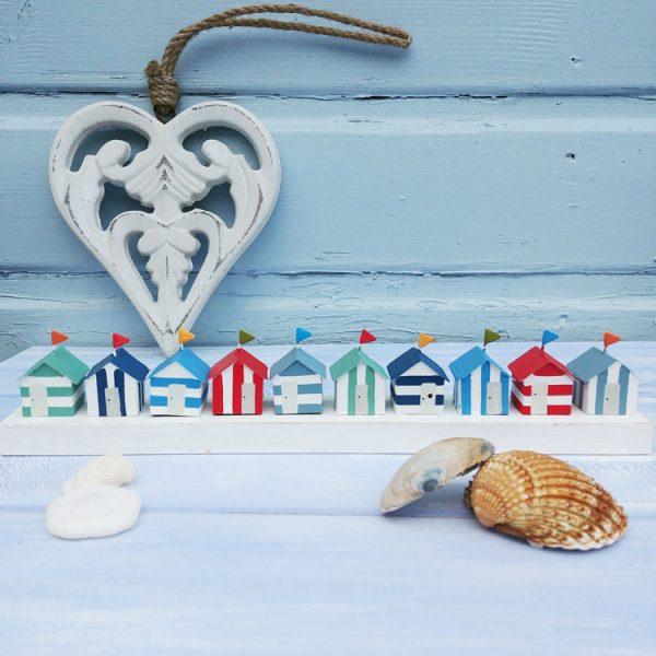 row of 10 decorative mini wooden beach huts