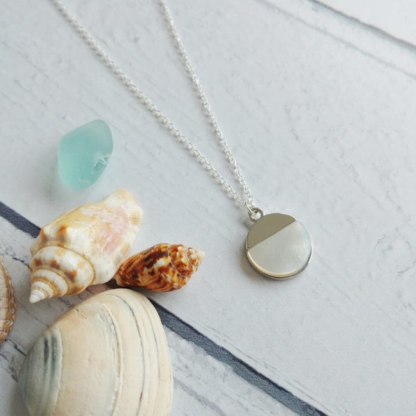White mother of pearl pendant necklace hung on a sterling silver fine trace chain