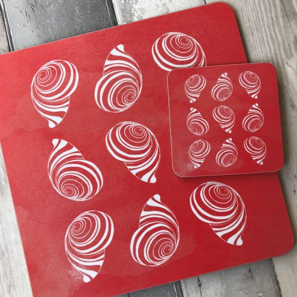 coral spiral shell placemats and coasters