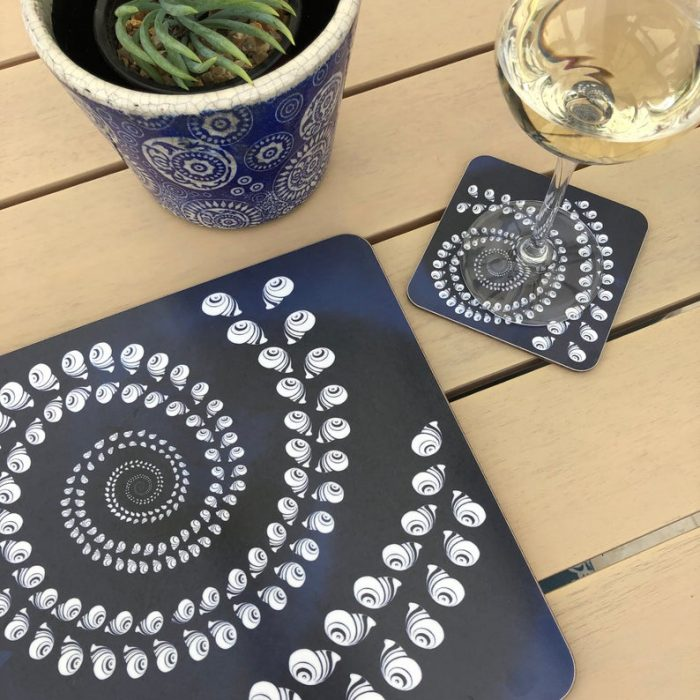 square navy blue spiral of shells placemats