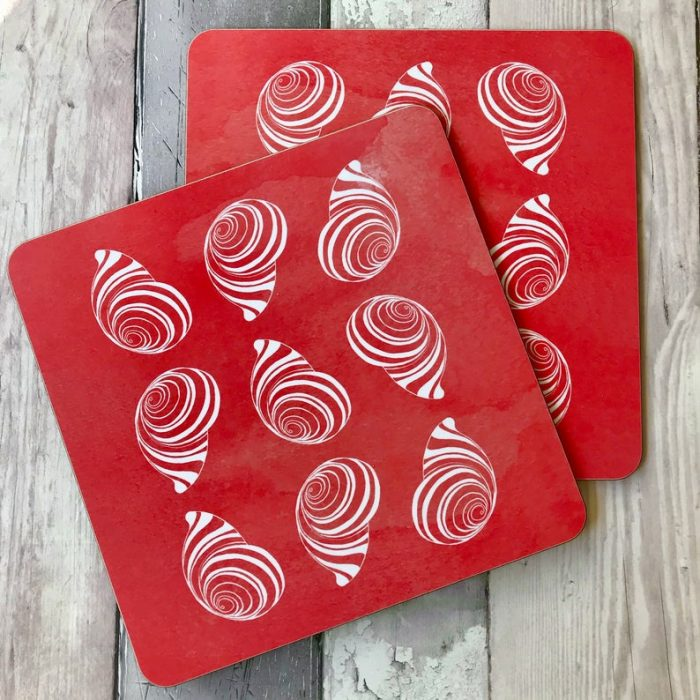 beautiful bright coral red coastal shell coasters with hand drawn shells contrasted with a gorgeous watercolour background