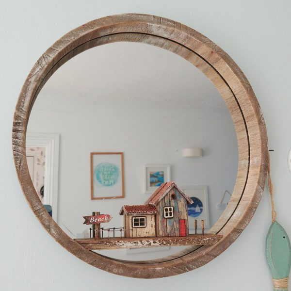 round wood mirror with beach themed shelf