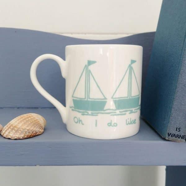 sailboat oh I do like to be beside the seaside mug