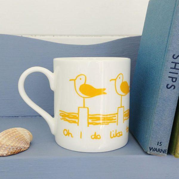 yellow seagull oh I do like to be beside the seaside mug